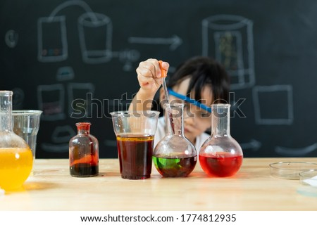 Adorable asian little girl is make easy scientific experimental at home, concept of learn from home, child STEM education and science for kid. Сток-фото ©