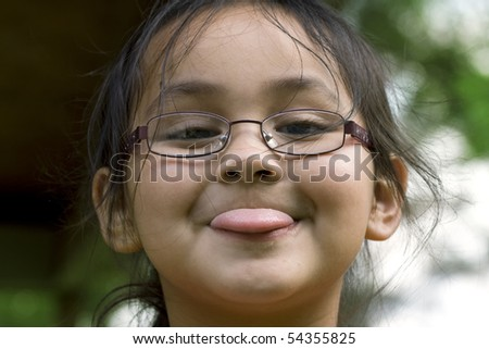 Adorable Asian making a funny face