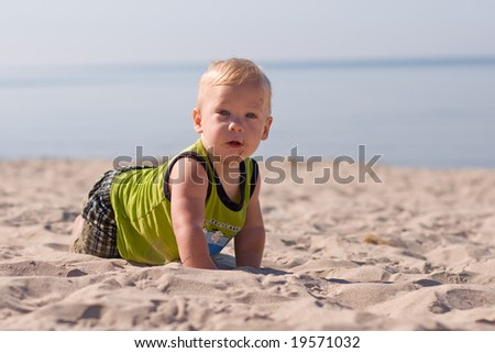 Adorable baby at the beach