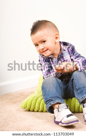 adorable baby boy portrait sitting on a pillow