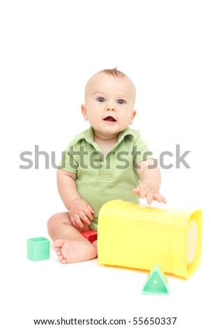 Adorable Baby Boy sitting and playing with blocks, on white background