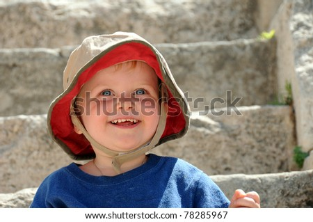 Adorable baby boy smiling on steps