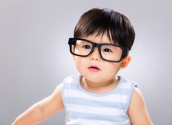 Adorable baby boy wearing glasses
