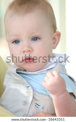 Adorable baby boy with blue eyes