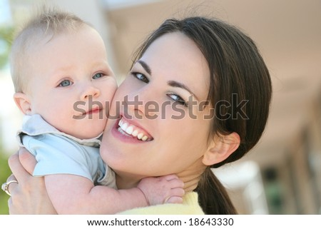 Adorable baby boy with blue eyes, with his mom