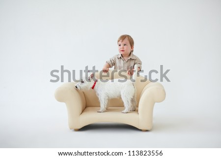 Adorable baby boy with white dog