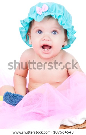Adorable baby, caucasian, blonde and with stunning blue eyes. The girl is isolated on white. The kid is playing with bath toys.