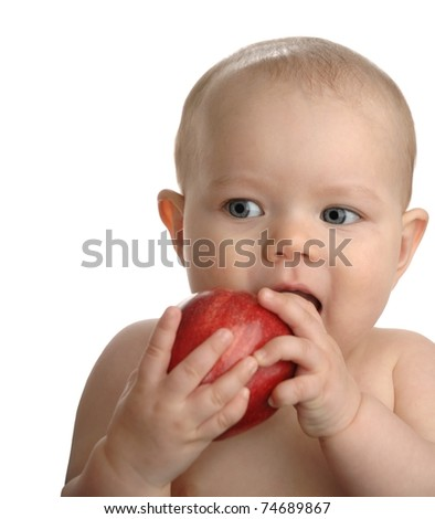 Adorable baby girl a red apple isolated on a white background.