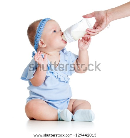 adorable baby girl drinking from bottle with help of mother