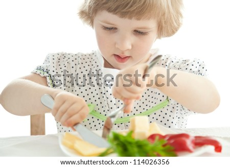 Adorable baby girl eating; healthy eating for a baby