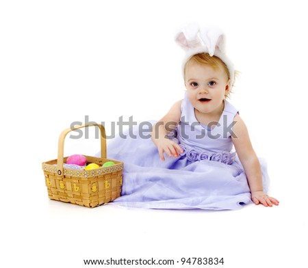 Adorable baby girl in Easter dress and bunny ears