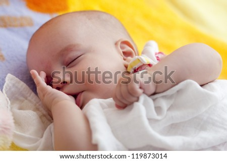 Adorable Baby Girl is sleeping in the bed
