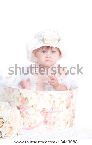 Adorable Baby Girl Playing Dress Up
