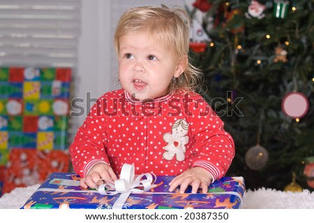 Adorable Baby Girl with Christmas gift