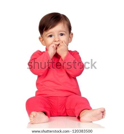 Adorable baby girl with her hand in mouth isolated on white background