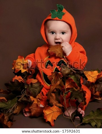 adorable baby in a pumpkin halloween costume