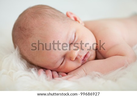 adorable baby newborn sleeping on stomach