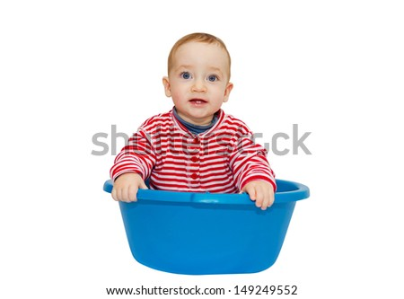 Adorable baby sit in a blue basin, isolated on a white background