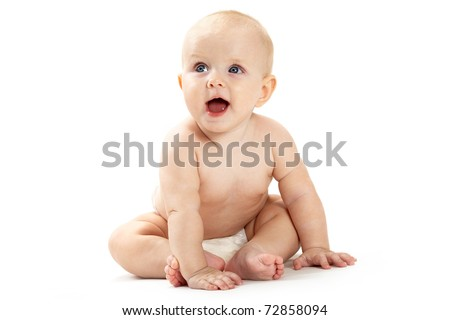 Adorable baby sitting and looking aside over white background