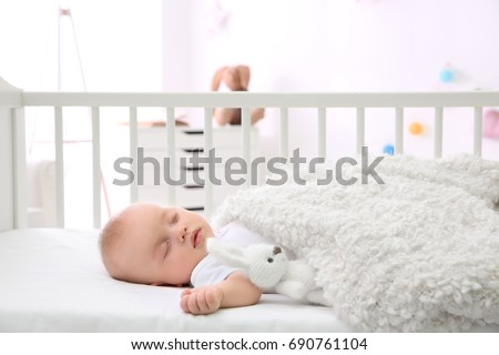 Adorable baby sleeping in cradle at home Foto stock ©