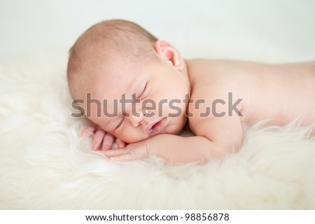 adorable baby sleeping on stomach
