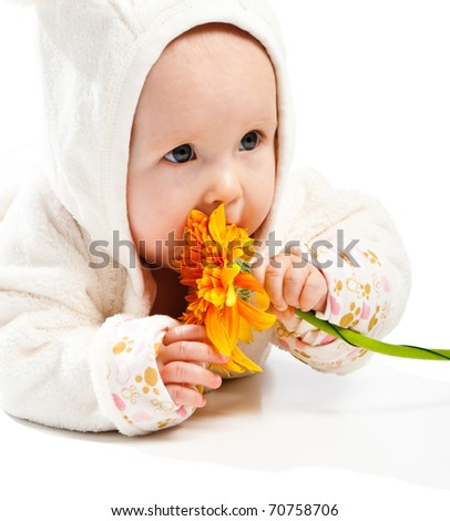 Adorable baby with orange flower