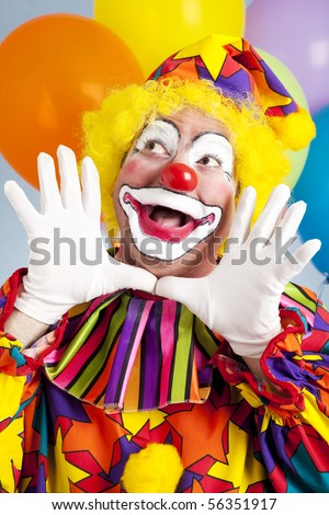 Adorable birthday clown making a jazz hands gesture. - stock photo