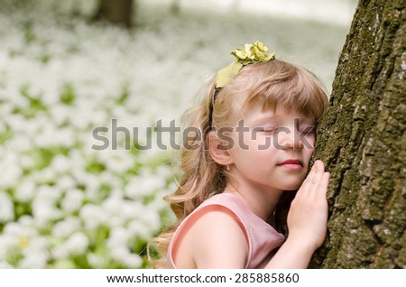 adorable blond girl princess dreaming in woods