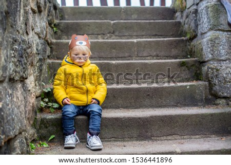 Adorable blond toddler child with bear mask and painted face, smiling #1536441896