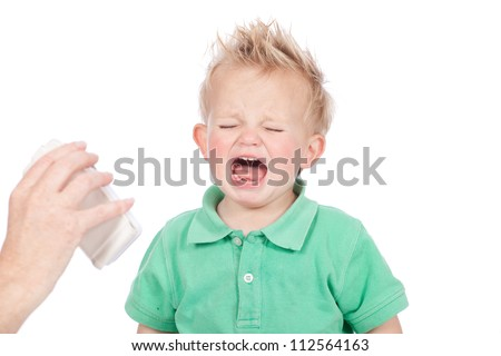 Adorable blue eyed blonde hair baby boy wearing green polo shirt, screaming and crying in temper tantrum