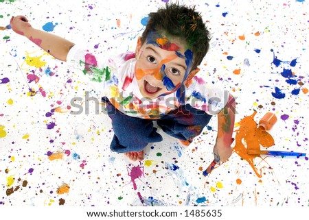 Adorable boy child with colorful paint on self and floor