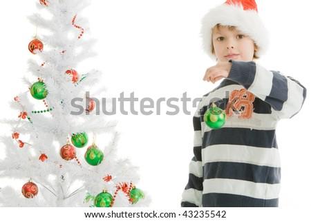 adorable Boy decorating Christmas tree