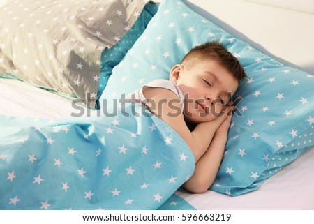 Stock Photo Adorable boy sleeping in bed