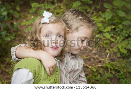 Adorable Brother and Sister Children Hugging Each Other Outside.