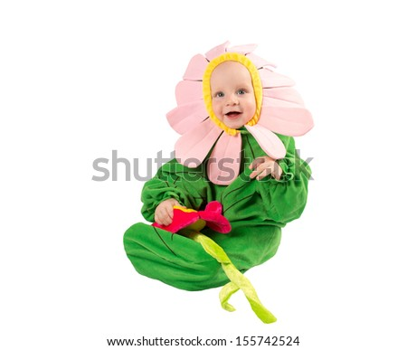Adorable c��hild boy, dressed in flower costume on white background. The concept of childhood and holiday