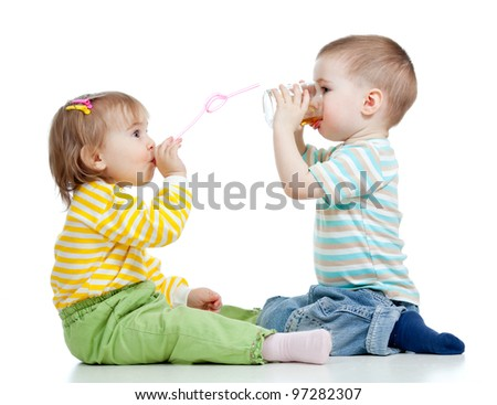 adorable child drinking juice from glass