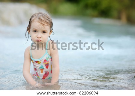 Adorable child in swimming suit on a beach