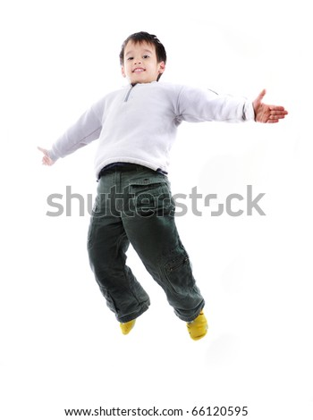 Adorable child jumping proudly a over white background