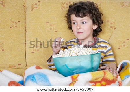 adorable child Watching TV in his home