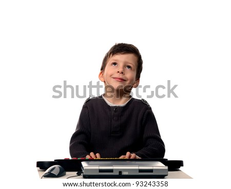 Adorable child with electric piano and laptop looking up, isolated on white