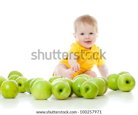 Adorable child with green apples