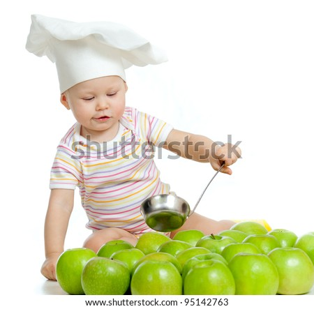 Adorable child with healthy food green apples