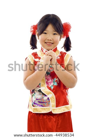 Adorable Chinese little girl wishing you  a happy and prosperous Chinese New year!   Gong Xi Fa Cai !  Isolated over white