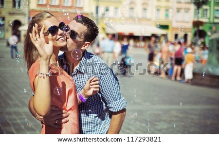 Adorable couple on a sunny day - stock photo