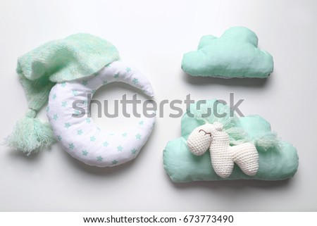 Adorable crochet toy with baby clothes and pillows isolated on white #673773490