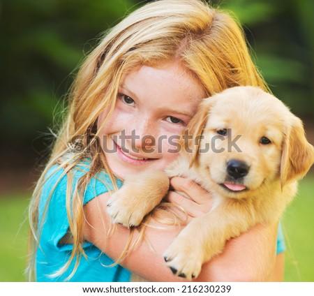 Adorable Cute Young Girl with Golden Retriever Puppy  #216230239