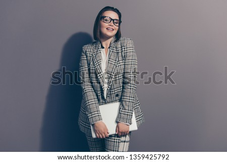 Adorable dreamy  dreamy cute charming elegant graceful pretty attractive she her woman using netbook for work wearing checkered plaid suit pants trousers isolated grey background #1359425792