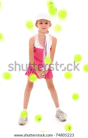Adorable eight year old girl tennis player being pelted with tennis balls over white background