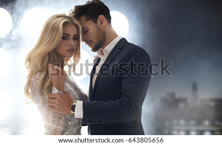 Adorable, elegant woman seducing her handsome boyfriend