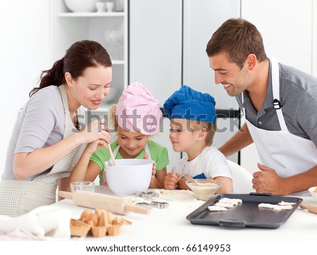 stock photo : Adorable family baking together in the kitchen to make ...